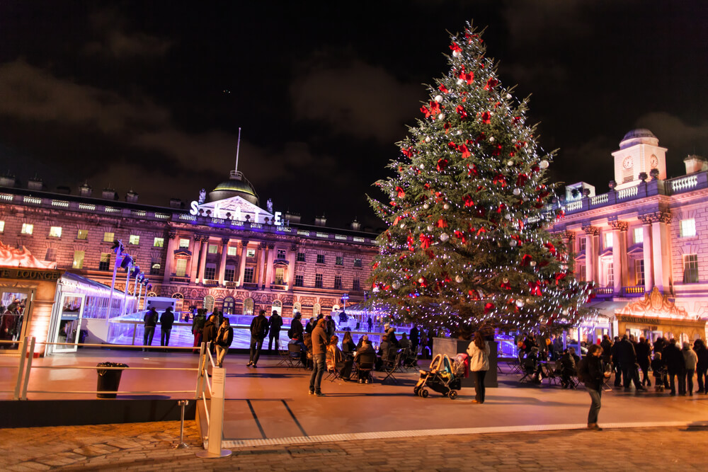 Somerset place (central London) pictured at night with Christmas tree and ice-skating rink