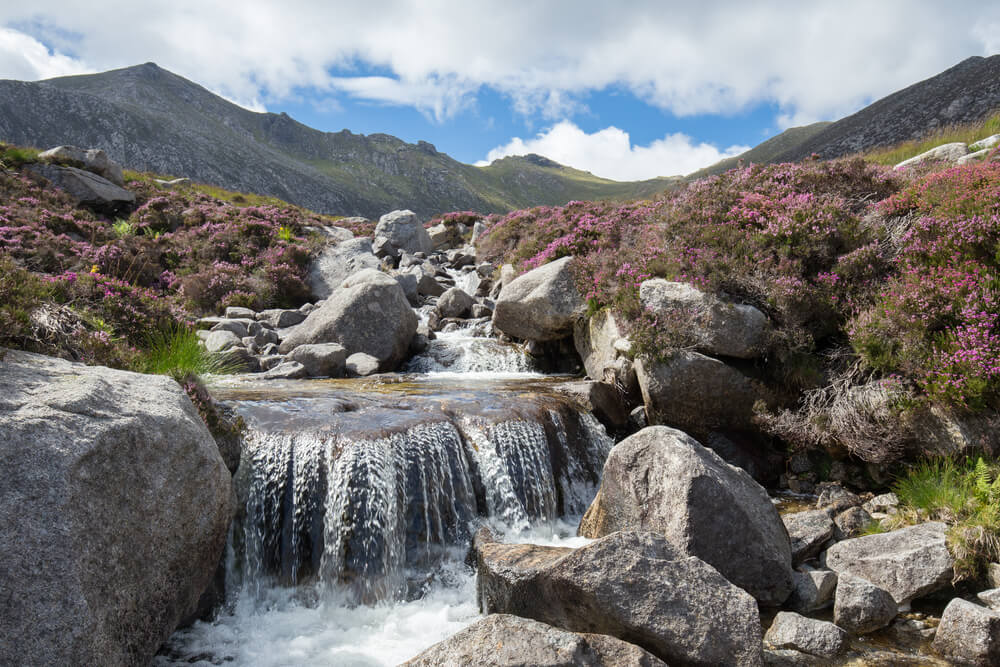 Idyllic waterfall in the Scottish Highlands on a beautiful Summer day, Isle of Arran, Goatfell mountain, Scotland